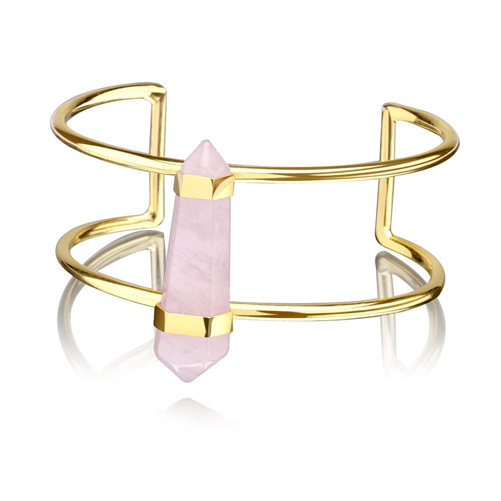 A pulseira dourada feminina Euro é um acessório da coleção Quartzo. Ela é  rígida, do tipo bracelete. Tem uma pedra quartzo na cor rosa bebê no centro. 67d60f371b